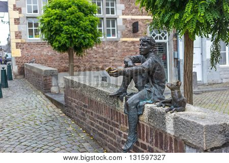 Statue of a boy and a dog in Maastricht, Netherlands
