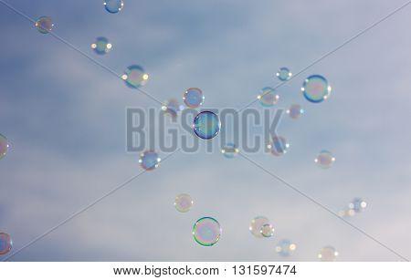 lot of bubbles against the blue sky