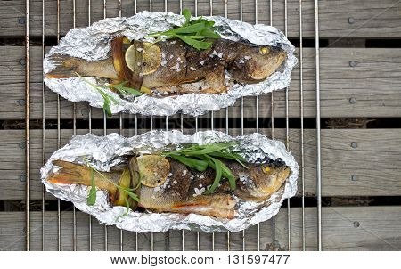 roasted seabass in a dish on wooden table