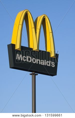 ENKHUIZEN, THE NETHERLANDS - 4 FEBRUARY 2015: Yellow sign advertising the mcdonalds with a blue sky in the background