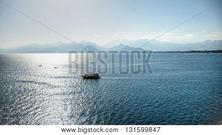 Antalya, Turkey - October 16, 2013: A boat sailing out of the old harbor of Antalya