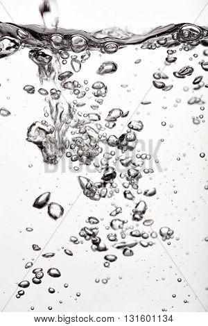 Water splash and bubbles on white background
