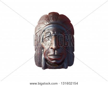 Wood carving redskin on isolated white background