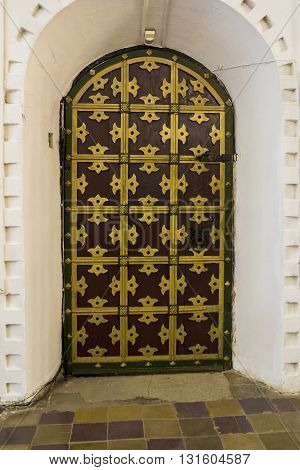 ROSTOV RUSSIA - JUNE 3 2013: Rostov Kremlin. Detail of ancient Russian architecture: the door of the 16th century.