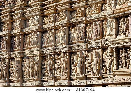 Ancient erotic bas-relief in Khajuraho temple, India.