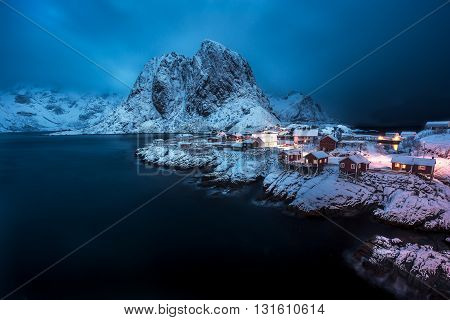 Snow falls over Hamnoy in the Lofoten Islands of Norway.
