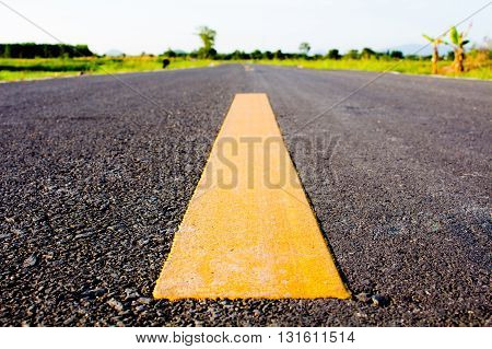 Yellow line on the road Way of success