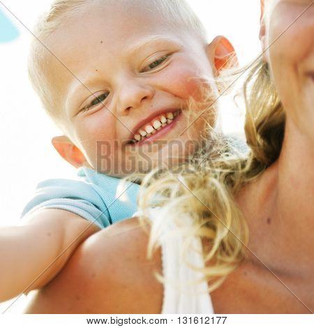 Mother and Son Having Fun Beach Concept