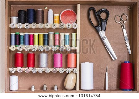 Sewing tools and sewing kit in a wooden box