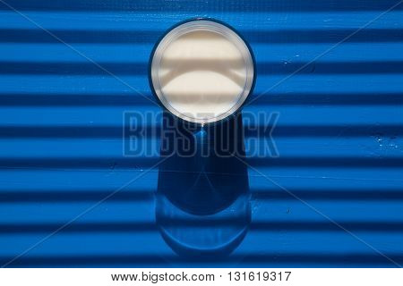 Glass of milk in front of sunblind - Flat Lay Photography