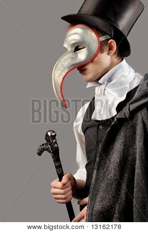 Portrait of a young gentlemen wearing masquerade costume. Shot in a studio.