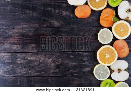 Slices Of Healthy Fruits Closeup On Rustic Wood With Copy Space