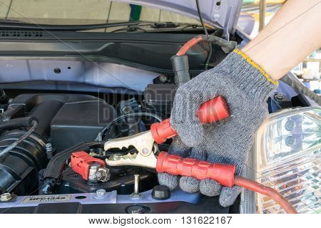 automotive technician charging vehicle battery. car, battery, charger, auto,