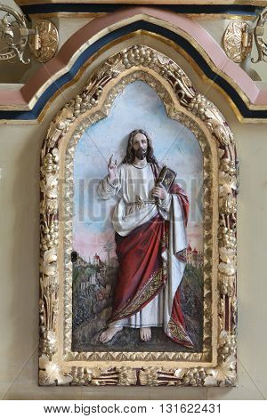 STITAR, CROATIA - AUGUST 27: Jesus relief on the door of tabernacle on the main altar in the church of Saint Matthew in Stitar, Croatia on August 27, 2015
