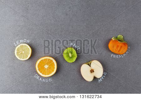 Slices Of Fruit With Labels On Stone