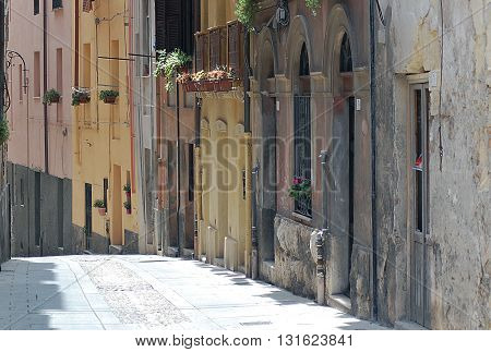 Narrow empty street in old town of Cagliari, Italy