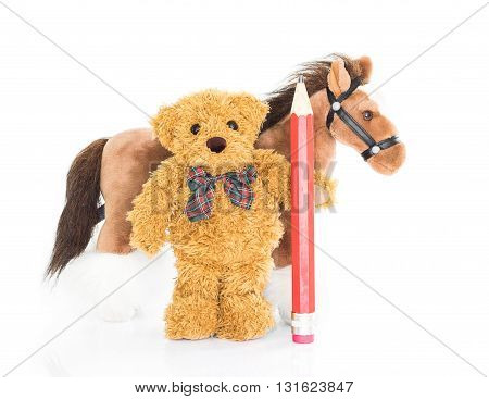 Teddy bear with red pencil and horses on white background