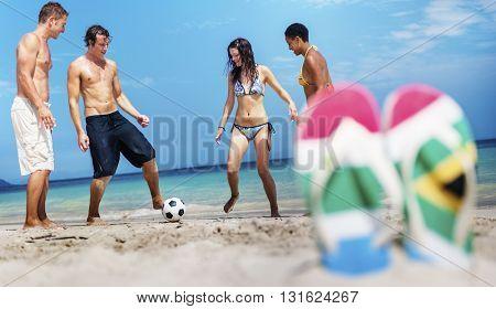 Friends Playing Beach Football Summer Concept
