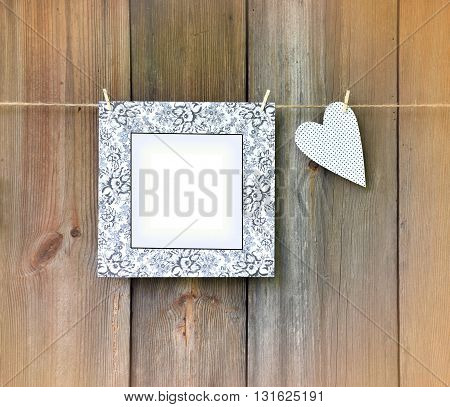 Heart and frame on the wooden background. Love message. Wedding Greeting. Postcard Mother's Day. The expression of love.Vintage.