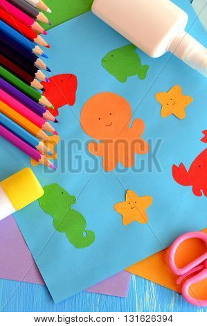 Preschool sea animals arts and crafts. Paper ocean animals. Kindergarten. Early childhood education. Pencils, glue, scissors, colored paper. Kids background