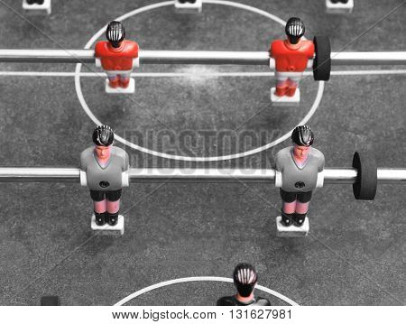 Vintage foosball. Black and white photo with elements of red color.