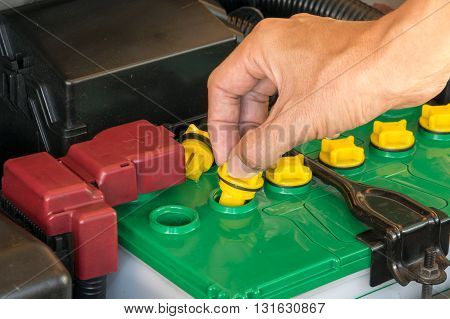 mechanic the battery of a car. car, battery, repair, automotive,