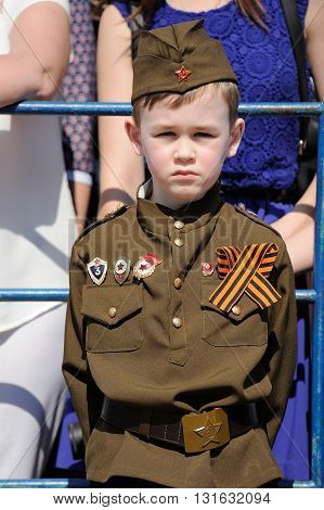 Orel Russia - May 9 2016: Celebration of 71th anniversary of the Victory Day (WWII). Kid in military uniform vertical