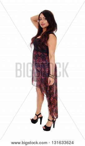 An young East Indian woman standing in a long dress and high heels isolated for white background.