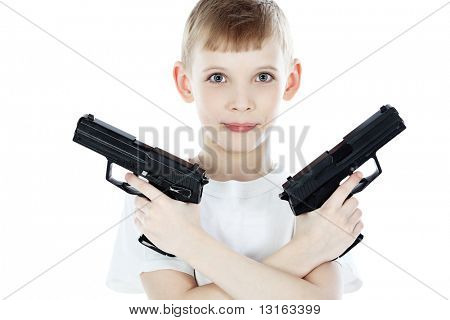 Shot of a boy with two guns. Isolated over white background.