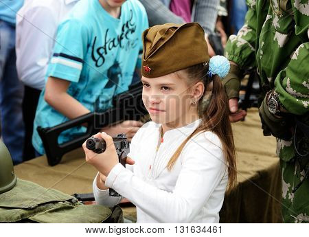 Orel Russia - May 9 2016: Celebration of 71th anniversary of the Victory Day (WWII). Girl with a gun closeup