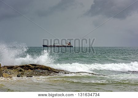 Ship docked during the storm in the Bay of All Saints in Salvador
