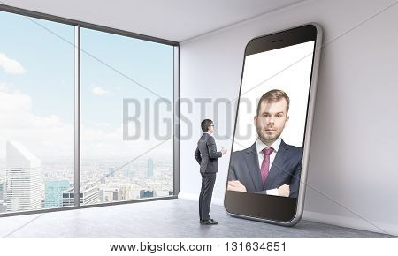 Businesspeople having online video conference on large smart phone in empty interior with Singapore city view. 3D Rendering