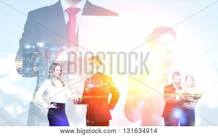 Concept of teamwork with businessmen and women cooperating on night city background. Double exposure