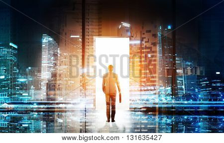 Success concept with businessman entering open door with white light on night city background. Double exposure
