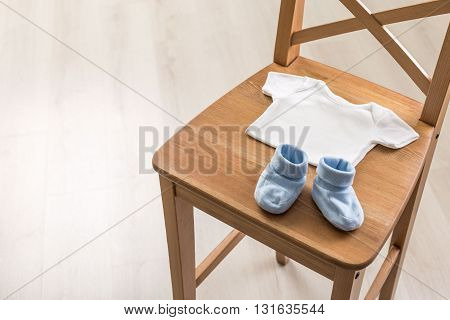 Wooden chair with baby items, close up