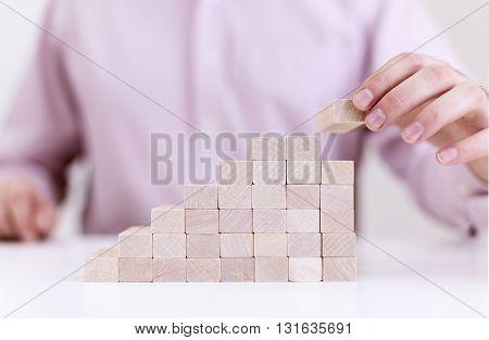 Businessman Assmebling Ladder