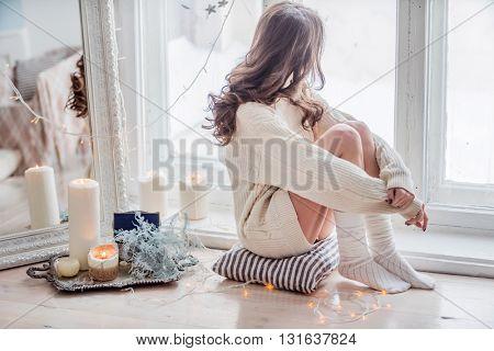beautiful women relaxing near window