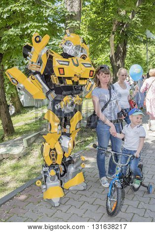 Rostov-on-Don Russia- May 22, 2016: Robotic speaks with the kids at a carnival in the park named after V. Cherevichkin