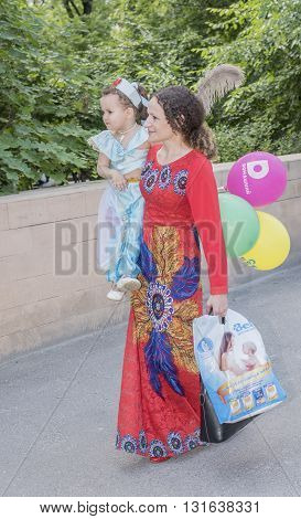 Rostov-on-Don Russia- May 22, 2016: Mother walks with her daughter in carnival costume