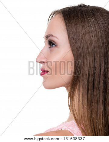 Profile side portrait of beautiful young woman, isolated over white background