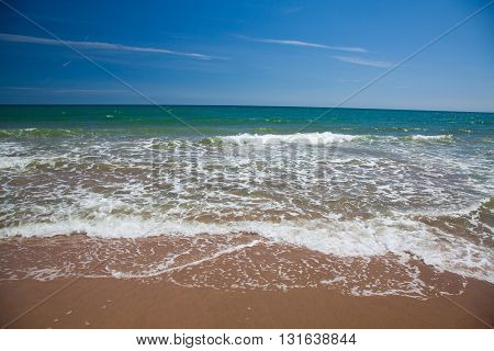 Surf At A Beach With Blue Sky