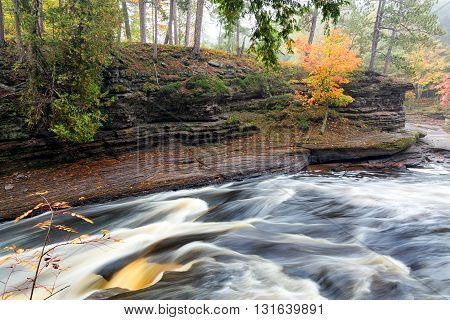 Presque Isle River runs through the Porcupine Mountains in Upper Michigan during the autumn season