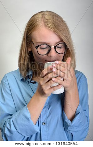 Beautiful And Smiling Woman With A Cup Of Tea