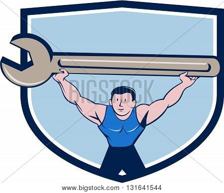 Illustration of a mechanic lifting giant spanner wrench over head viewed from front set inside shield crest on isolated background done in cartoon style.