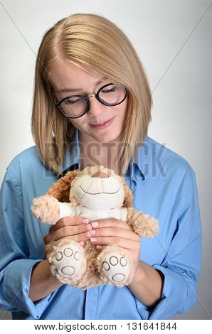 Beautiful Young Woman Holding A Teddy Bear.
