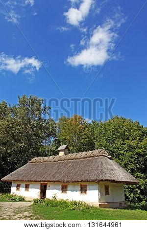 Old traditional house in the summer in Pirogovo, Ukraine