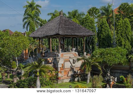 An altar in a garden setting in a courtyard in Bali Indonesia