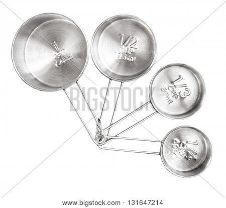 metal measuring spoons on a black table