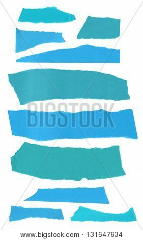 A collection of pieces of teal blue torn paper isolated on white