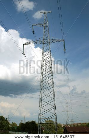 High voltage powerlineon blue sky background (electricity transmission)